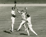 Dodgers centerfielder John Shelby (L) leaps for joy after making a game ending catch as teammates Mike Marshall and Steve Sax (R) celebrate during Game 5 of the NLCS Monday, October 10, 1988 at Shea Stadium.  © Jon SooHoo/Los Angeles Dodgers 1988