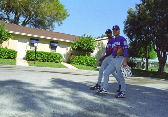 2001 teammates Ramon Martinez and Chan Ho Park walk from the Fields 5 and 6 to the clubhouse at Dodgertown in Vero Beach,Florida. Photo by Jon SooHoo/©LA Dodgers