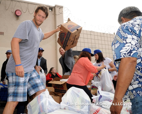 Los Angeles Dodgers Clayton Kershaw helps the Dream Center