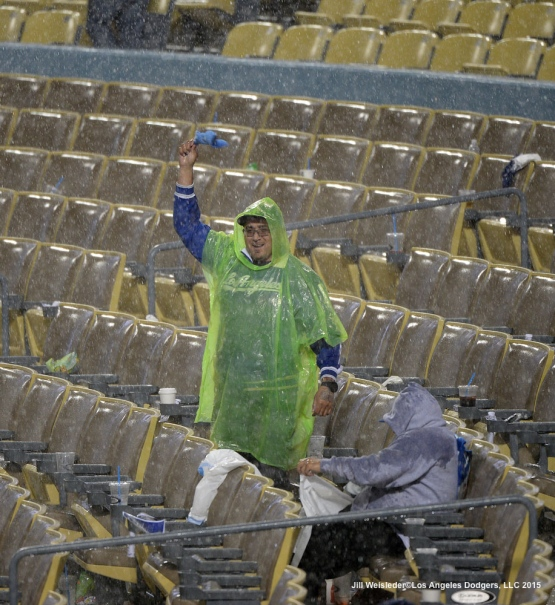 A sole Dodger fan shows his support during the rain delay. Jill Weisleder/LA Dodgers
