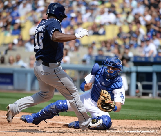 Dodger catcher Austin Barnes gets ready to apply the tag on San Diego Padres' Abraham Almonte at home plate. Jill Weisleder/Dodgers
