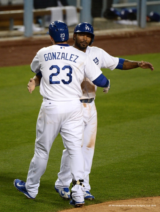 Howie Kendrick congratulates Adrian Gonzalez after getting a two-run homer. Jill Weisleder/LA Dodgers
