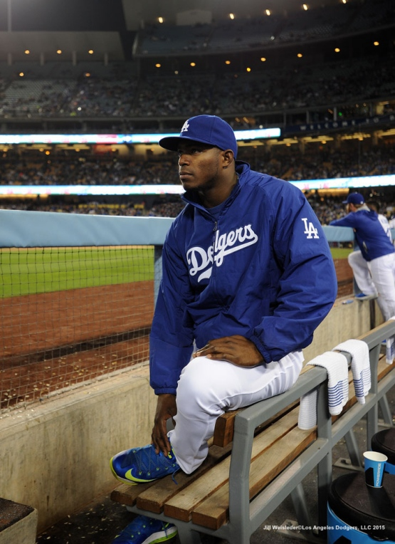 Yasiel Puig watches the game from the dugout. Jill Weisleder/LA Dodgers