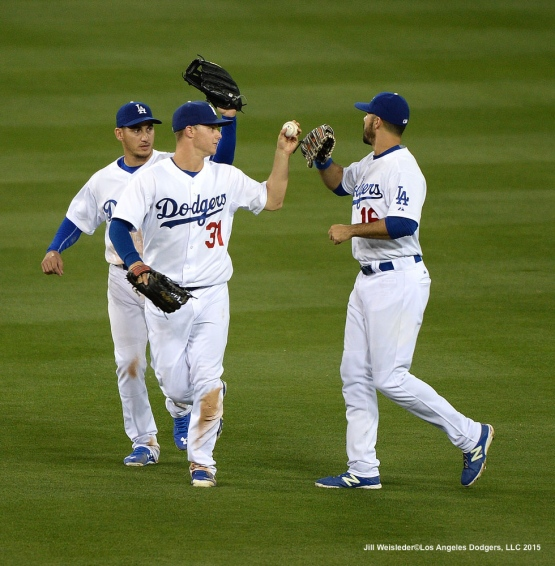 Alex Guerrero, Joc Pderson and Andre Ethier celebrate a 8-0 win against the Atlanta Braves. Jill Weisleder/LA Dodgers