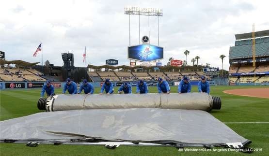 The Dodger grounds crew rolls the rain tarp and prepares the field. Jill Weisleder/LA Dodgers
