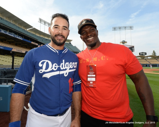 Andre Ethier and U.S. Marine Corps Sergeant Ladarrius Robinson  poses for a photo prior to the game. Jill Weisleder/LA Dodgers