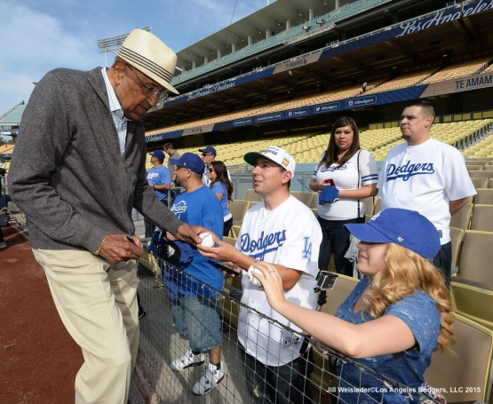 Former Dodger Don Newcombe signs autographs prior to the start of the game against the Atlanta Braves. Jill Weisleder/LA Dodgers