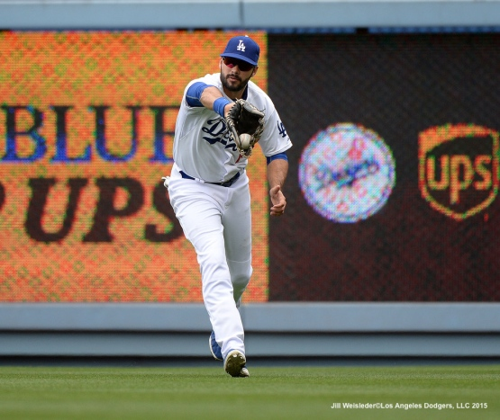 Andre Ethier keeps his eye on the ball to make the catch. Jill Weisleder/Dodgers