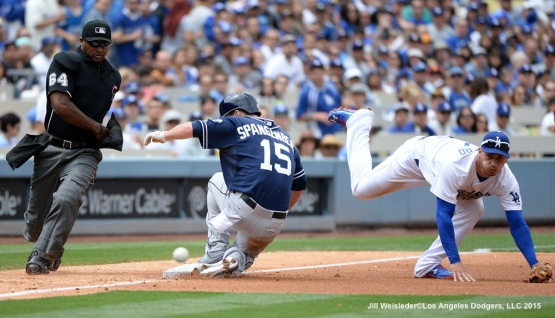 San Diego Padres' Cory Spangenberg is safe at third base as Alex Guerrero watches the ball. Jill Weisleder/Dodgers