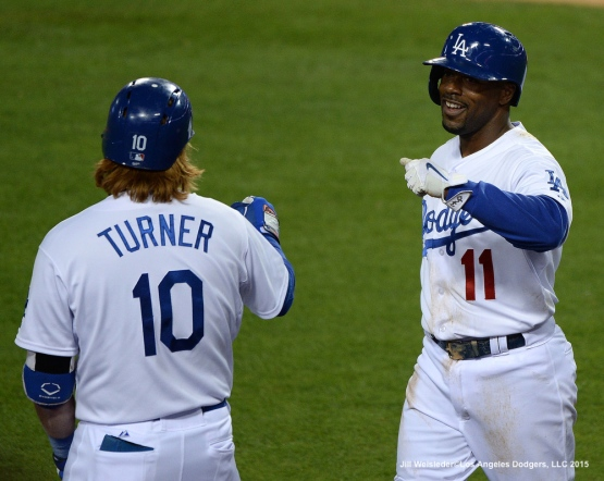 Justin Turner congratulates Jimmy Rollins after scoring in a run in the 4th inning . Jill Weisleder/LA Dodgers