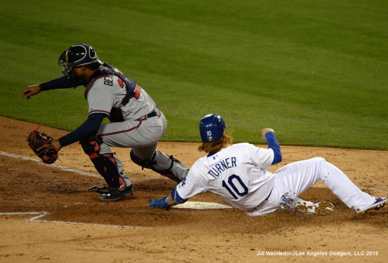 Justin Turner slides home safely under the glove of Atlanta Braves catcher Christian Bethancourt. Jill Weisleder/LA Dodgers