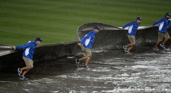 The grounds crew prepares the tarp on the field. Jill Weisleder/LA Dodgers