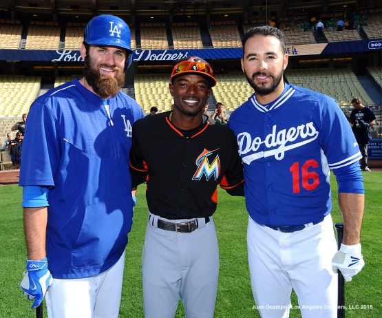 Scott Van Slyke, Dee Gordon and Andre Ethier pose for a photo before the game between the Dodgers and Marlins.