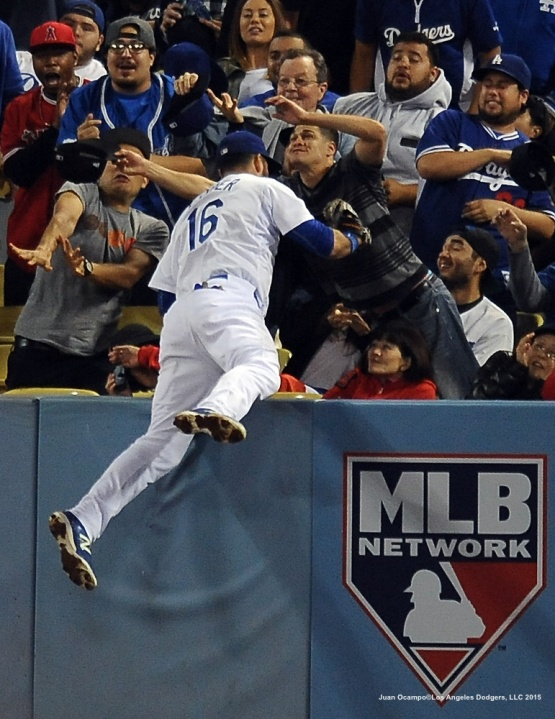 Andre Ethier climbs the wall for a foul ball.
