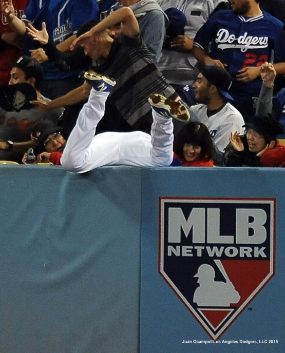 Andre Ethier leaps over the wall but can't come up with the foul ball in the eighth inning.