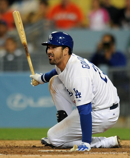 Adrian Gonzalez watches the flight of the ball.