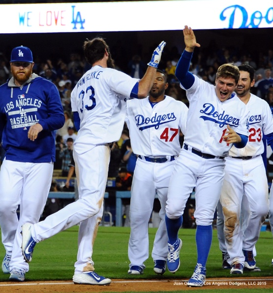 Scott Van Slyke is congratulated by his teammates after his game winning home run. The Dodgers beat the Marlins, 5-3