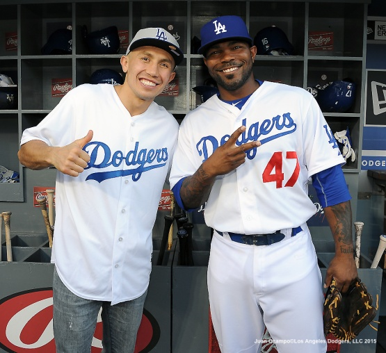 "Middleweight boxer Gennady ""Triple G"" Golovkin and Howie Kendrick pose for a photo in the dugout."