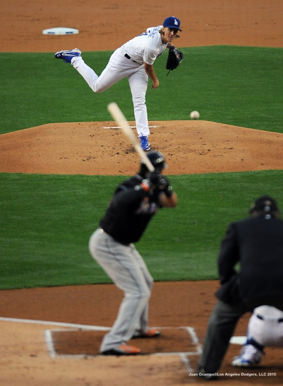 Zack Greinke throws to the plate against the Miami Marlins.