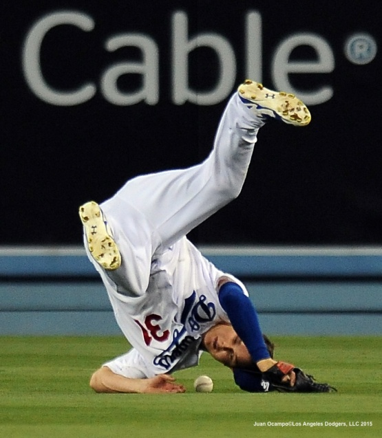 Joc Pederson flips over attempting to make the catch.