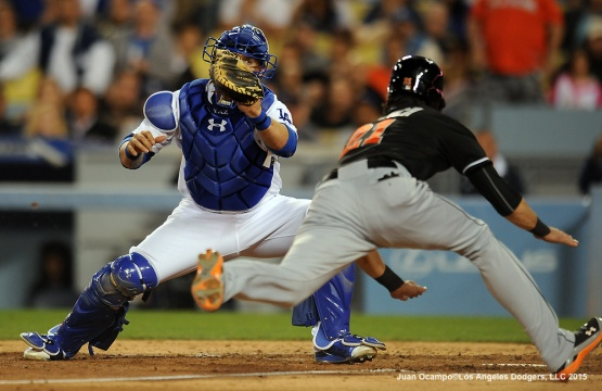 Yasamani Grandal gets set to tag out the Marlins' Christian Yelich at home in the seventh inning.