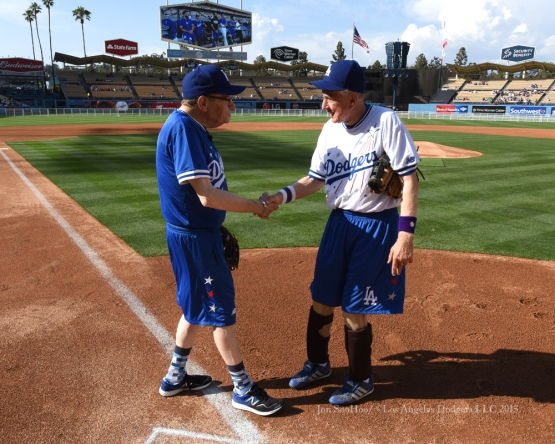 Larry King and Garry Marshall shake hands before the Hollywood Stars Night prior to Los Angeles Dodgers game against the St.Louis Cardinals Saturday, June 6, 2015 at Dodger Stadium in Los Angeles,California. Photo by Jon SooHoo/©Los Angeles Dodgers,LLC 2015
