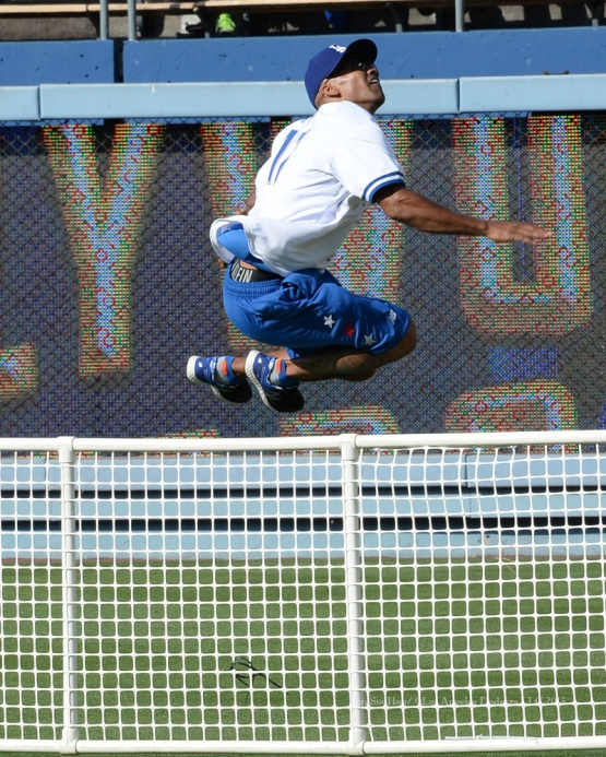 Shemar Moore leaps the right field fence during the Hollywood Stars softball game prior to Los Angeles Dodgers game against the St.Louis Cardinals Saturday, June 6, 2015 at Dodger Stadium in Los Angeles,California. Photo by Jon SooHoo/©Los Angeles Dodgers,LLC 2015