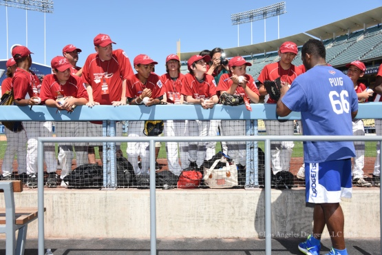 Los Angeles Dodger Yasiel Puig signs for Westchester Little League prior to game against the St.Louis Cardinals Sunday, June 7, 2015 at Dodger Stadium in Los Angeles,California. Photo by Jon SooHoo/©Los Angeles Dodgers,LLC 2015