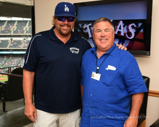 Toby Keith poses with Bobby Patton prior to the game against the Texas Rangers Tuesday, June 16, 2015 at  Globe Life Park in Arlington Park,Texas. The Rangers beat the Dodgers 3-2.  Photo by Jon SooHoo/© Los Angeles Dodgers,LLC 2015