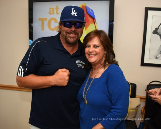 Toby Keith poses with Sherri Patton prior to the game against the Texas Rangers Tuesday, June 16, 2015 at  Globe Life Park in Arlington Park,Texas. The Rangers beat the Dodgers 3-2.  Photo by Jon SooHoo/© Los Angeles Dodgers,LLC 2015