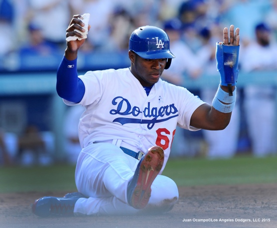 Yasiel Puig scores in the second inning.