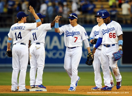 The Dodgers celebrate their 10-2 win over the Giants.