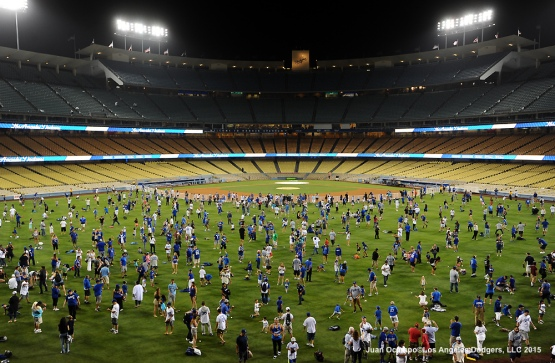 Fans take part in a Fathers Day Catch, presented by Famer John, after the game.