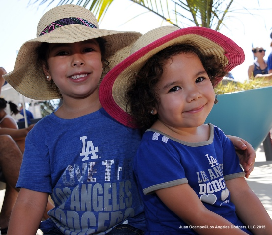 Two young fans pose for a photo during Viva Los Dodgers before the game.