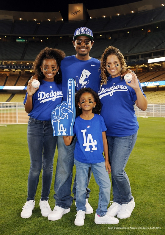 A family poses for a photo during the Father's Day Catch.