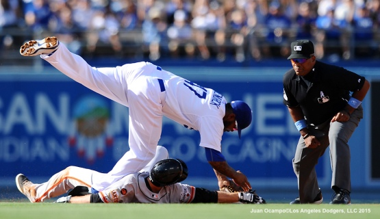 Howie Kendrick tags out the Giants' Matt Duffy at second base as umpire Laz Diaz looks on in the first inning.