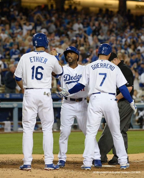 Andre Ethier and Alex Guerrero high-fives Jimmy Rollins after getting a three-run home run in the fourth inning. Jill Weisleder/LA Dodgers