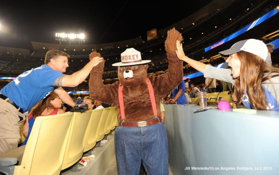 Smokey the Bear high-fives fans during the game. Jill Weisleder/LA Dodgers