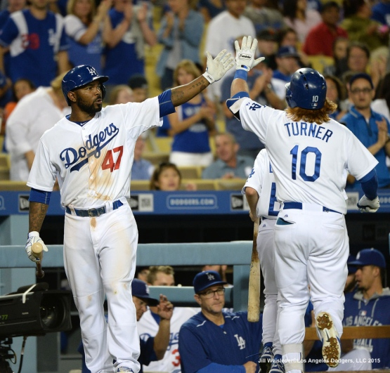 Howie Kendrick congratulates Justin Turner after knocking in a solo home run in the eighth inning. Jill Weisleder/LA Dodgers