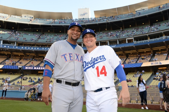 Kike Hernandez poses with Carlos Corporan prior to  game against the Texas Rangers Thursday, June 18, 2015 at Dodger Stadium. Photo by Jon SooHoo/©Los Angeles Dodgers,LLC 2015