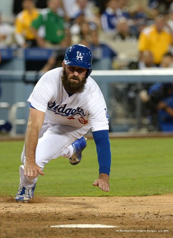 Scott Van Slyke slides home safely and scores in a run in the ninth inning. Jill Weisleder/LA Dodgers