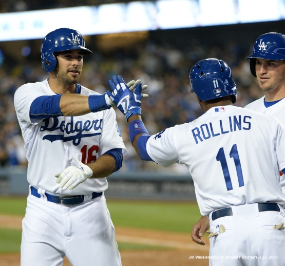 Andre Ethier is greeted by Jimmy Rollins as he scores in a three-run homer in the fifth inning. Jill Weisleder/LA Dodgers