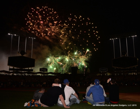 Fans watch Friday Night Fireworks on the field at Dodger Stadium. Jill Weisleder/LA Dodgers