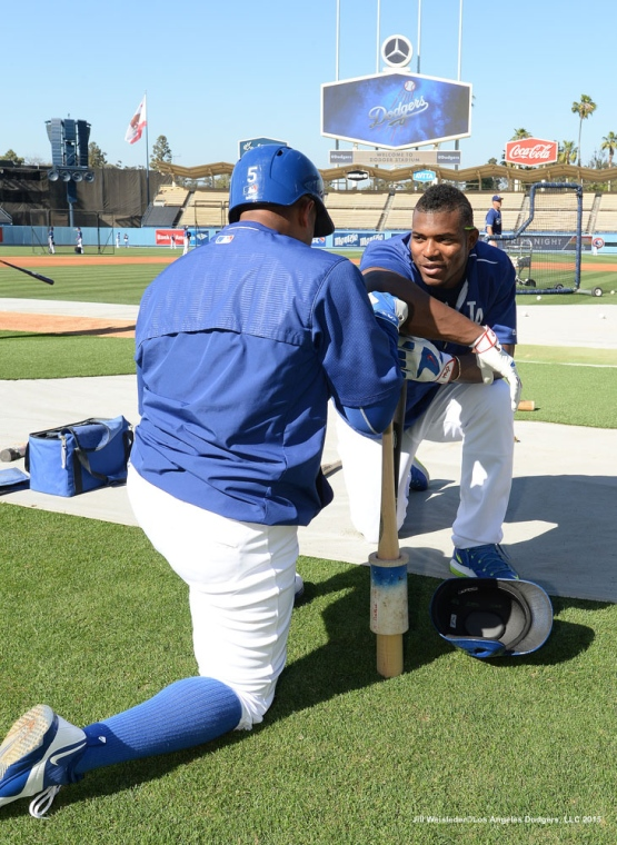 Yasiel Puig and Alberto Callaspo chat during batting practice. Jill Weisleder/LA Dodgers