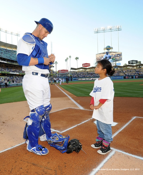 Yasmani Grandal signs a  ball for a young fan prior to the game. Jill Weisleder/LA Dodgers