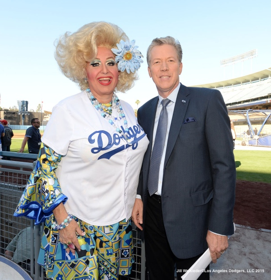 A Dodger fan and Orel Hershiser pose for a photo. Jill Weisleder/LA Dodgers