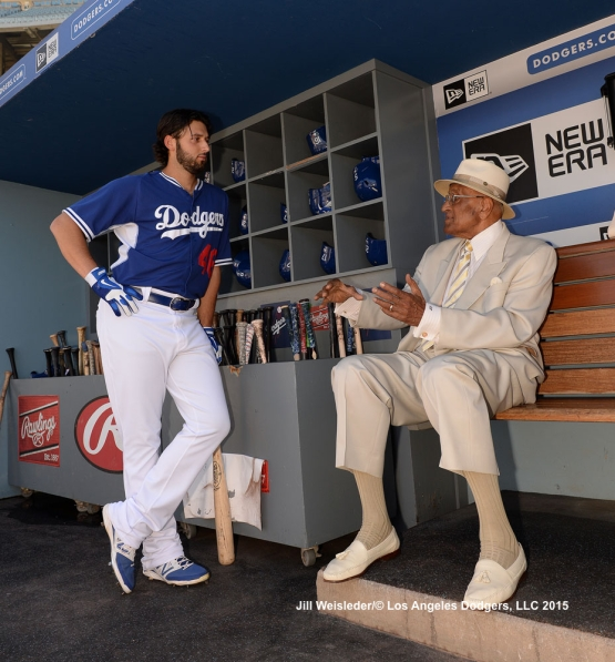 Pitcher Mike Bolsinger and former Dodger Don Newcombe chat in the dugout. Jill Weisleder/LA Dodgers