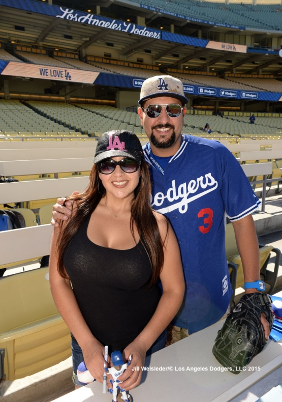 Dodger fans pose for a photo during batting practice. Jill Weisleder/LA Dodgers