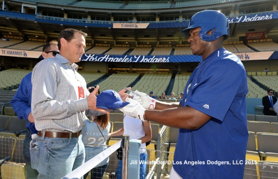 Yasiel Puig signs an autograph for a fan prior to the game. Jill Weisleder/LA Dodgers