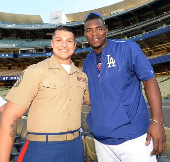 Yasiel Puig and U.S. Marine Corps Staff Sergeant Jaime Soto pose pose for a photo prior to the start of the game. Jill Weisleder/LA Dodgers